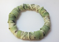 A patched corn husk wreath