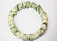 A corn husk wreath that is shrunken
