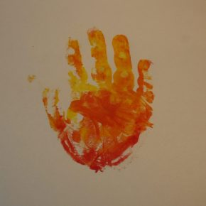 A flame colored handprint