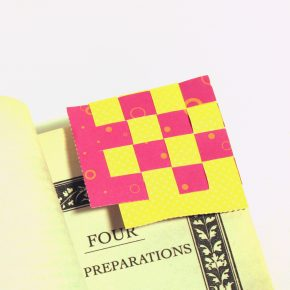 The finished bookmark on a page in a book
