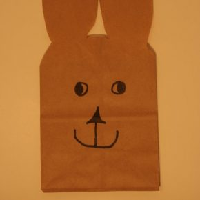 Draw the eyes, nose, and mouth on the bunny bag