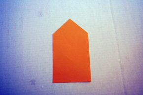 Cut out a shape.  It will look like a tall house