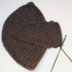 An ear flap is added to the hat