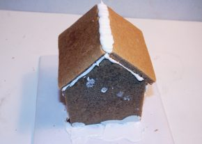 The roof is added to the gingerbread house