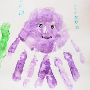 A purple octopus made with a handprint.