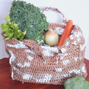A shopping bag made from old grocery bags.