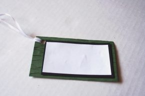The tag with the ribbon attached