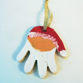 A Santa Claus handprint ornament