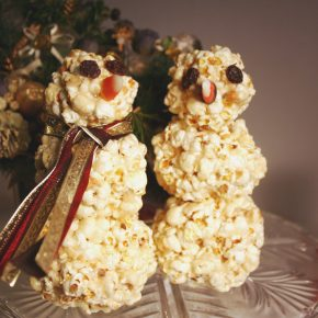 A pair of snowmen made from popcorn balls