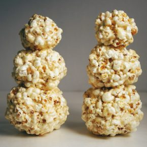 The popcorn balls have been stuck together, forming two snowmen