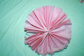 The folded paper is spread into a circular shape