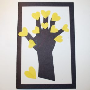 A handprint tree with heart shaped flowers
