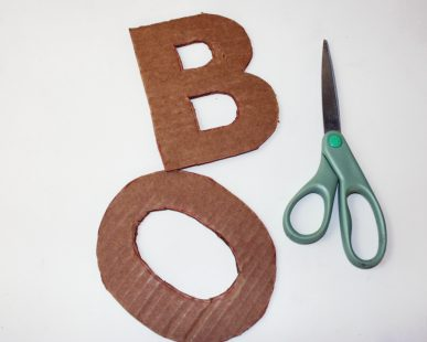Cardboard letters shaped like B and O