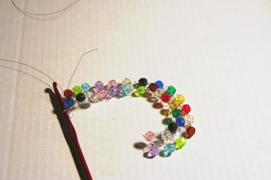 A strand of wire with lots of beads