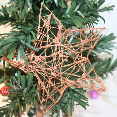 A metallic star Christmas ornament