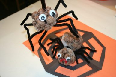 Two spiders made with tulle wrapped chocolate