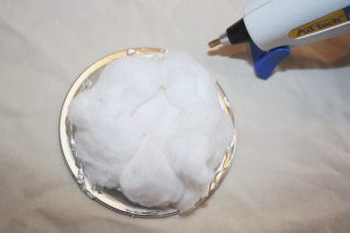 Cotton balls glued to the lid of a jar