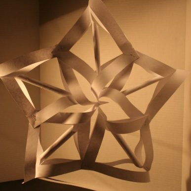 The 3-D paper star lighted and casting a shadow