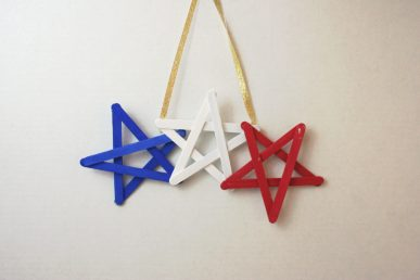 A red, white, and blue wall hanging.