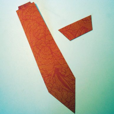 A tie cut out of orange paper