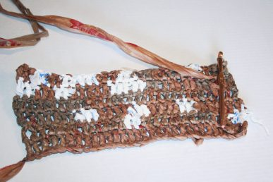 The bottom of the crocheted bag