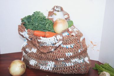 A shopping bag crocheted from other old bags