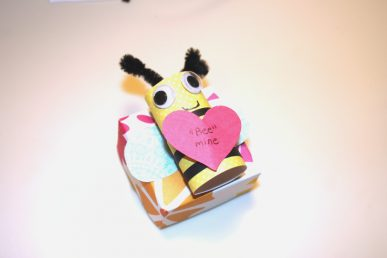 A paper bee on a small box