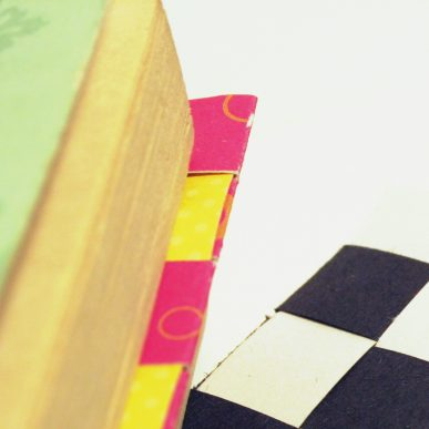 A corner of a book with the bookmark in place