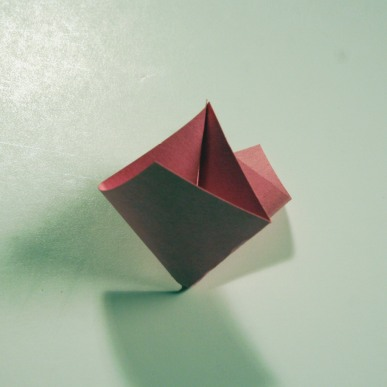 Pinch in the diagonal, fold back the edges