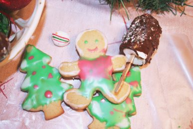 Decorated Christmas cookies; a gingerbread man and two Christmas trees