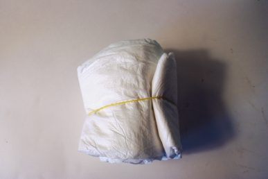 Diapers rolled together.