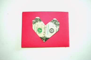 A card decorated with a dollar folded into a heart