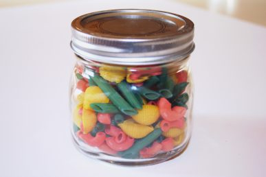 Brightly colored noodles in a jar