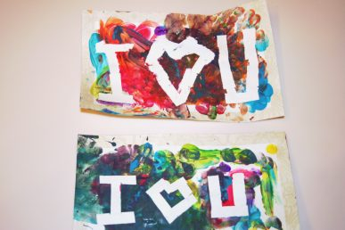 Two finger paint valentines with white messages