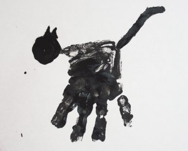 A cat made with a black handpirnt and a thumbpirnt