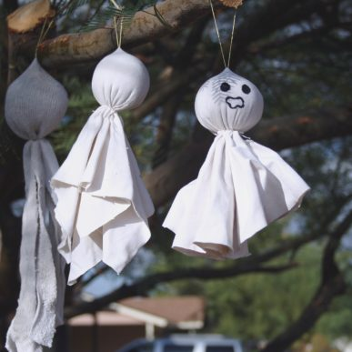 Little ghost hanging in a tree