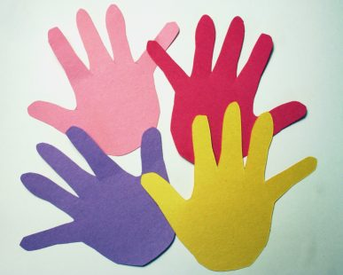 Handprints cut from colored paper