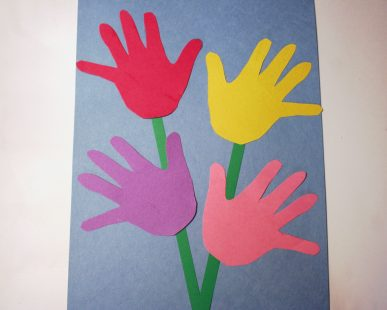 Use handprints to make blossoms.