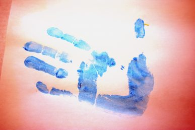 A sideways blue handprint