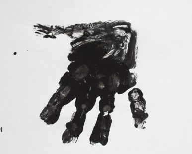 A handprint made with black paint