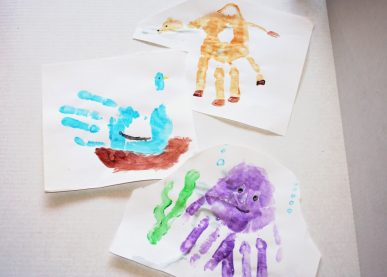 A collection of three handprint critters: a bird, an octopus, and a camel