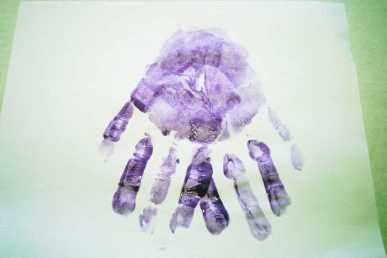 Two overlapping purple handprints