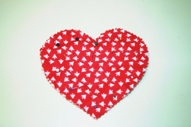 A stack of four heart pieces stacked and pinned in place