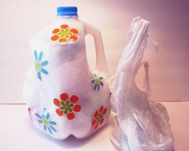 A container for plastic bags made from an old milk jug