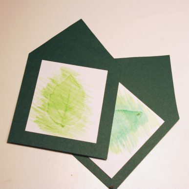 Two green leaf rubbing are pasted onto the green gift tags