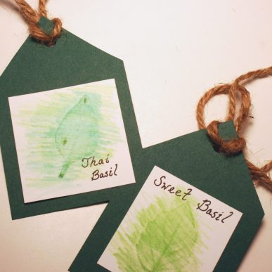 Two green gift tags with leaf rubbings