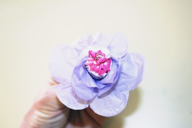The tissue paper wrapped around a lollipop to form flower petals