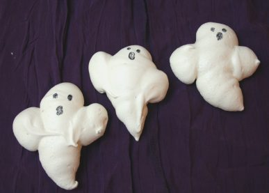 Three meringue cookies shaped like ghost for Halloween