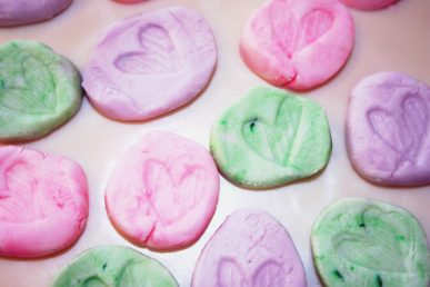 Pastel colored mints with stamped hearts