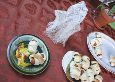 A table setting with hotdog mummy wraps